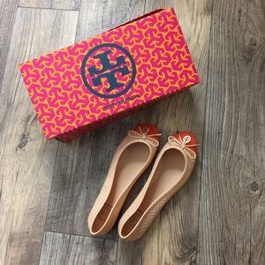 Tory Burch nude orange jelly bow flats